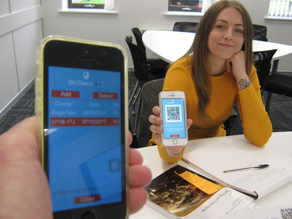 Demi Abrahams presenting her QR Code for scanning