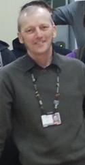 Associate Lecturer Roger Bradley advising tutor on app development